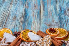 Christmas still life background with gingerbread cookies from festive ingredients. On wooden boards Stock Photos
