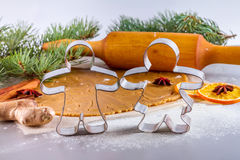 Christmas still life background with ingredients for baking. Christmas still life background - forms for gingerbread with silhouette of man and woman with Royalty Free Stock Images