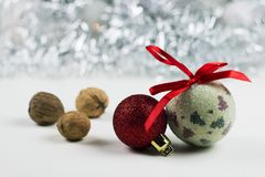 Christmas still life with balls and nuts for your card or design.  Royalty Free Stock Photography