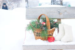 Christmas still life. Basket of fir branches, felt boots Royalty Free Stock Photos