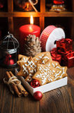 Christmas still life with biscuits. Ornaments, pine cones, wreaths and burning candle on a wooden background Royalty Free Stock Image