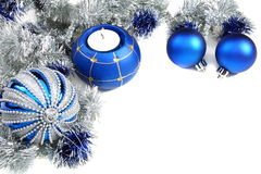 Christmas still life with blue balls and tinsel. Christmas still life with blue balls and tinsel on a white background stock images
