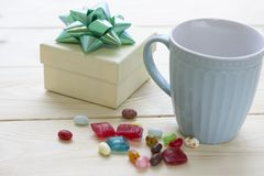 Christmas still life with a blue mugs and a gift box stock image