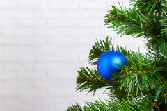Christmas still life, blue tree toy on a wooden table royalty free stock images