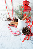Christmas still life with branches of tree, pinecone and cinnamo Stock Images