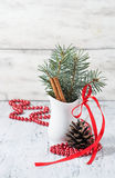 Christmas still life with branches of tree, pinecone and cinnamo Stock Photos