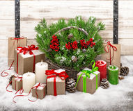 Christmas still life with burning candles and gift box decoratio Stock Photo