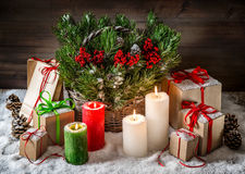 Christmas still life burning candles and gift box light effects Royalty Free Stock Image