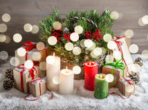 Christmas still life with burning candles gift box lights Stock Image