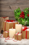 Christmas still life burning candles gift boxes and christmas tr Royalty Free Stock Images