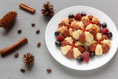 Christmas still life with cake with fresh berries on white plate. Selective focus.  Royalty Free Stock Images