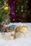 Christmas still life with candle, bells, gift and highlights in the background. Stock Images