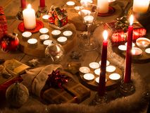 Christmas still life with candles of different size and shape, d royalty free stock photography