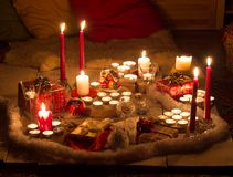 Christmas still life with candles of different size and shape, d Royalty Free Stock Image