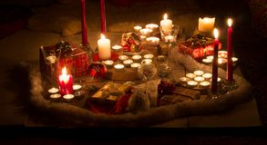 Christmas still life with candles of different size and shape, d stock photography