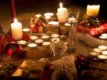 Christmas still life with candles of different size and shape, d royalty free stock images