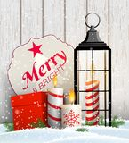 Christmas still-life with candles, gift box and old lantern stock illustration