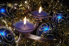Christmas still life with candles, glare and balls Royalty Free Stock Images