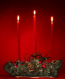 Christmas still life with candlestick on red. Royalty Free Stock Photos