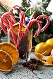 Christmas still life. With candy and tangerines Royalty Free Stock Photos