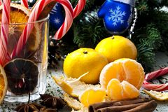 Christmas still life. With candy and tangerines Royalty Free Stock Images