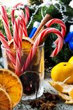 Christmas still life. With candy and tangerines Royalty Free Stock Image
