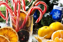Christmas still life. With candy and tangerines Stock Image