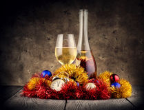Christmas still life with champagne and clock Royalty Free Stock Photo