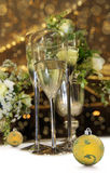 Christmas still life with champagne glasses. Glasses  champagne against a gold sparkle christmas background Royalty Free Stock Photography