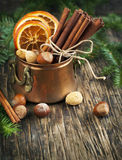 Christmas still life: cinnamon, nuts and fir branches Stock Photography