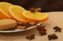 Christmas still life. With cinnamon and oranges Stock Photos