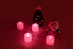 Christmas still life and clay figurines of Santa Claus and Christmas tree. Christmas still life and candles and clay figurines of Santa Claus and Christmas tree Royalty Free Stock Images