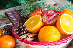 Christmas still life. Close up maffins, oranges and chocolate Stock Photo