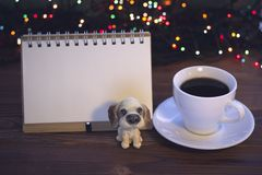 Christmas still life with coffee cup with a saucer, a toy and a notebook Stock Images