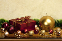 Christmas still life with color balls and candle. Christmas composition   with gift box and candle Stock Photo