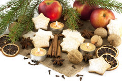 Christmas still life with cookies, candle and spices Royalty Free Stock Images