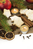 Christmas still life with cookies, candle and spices Royalty Free Stock Photo