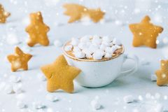 Christmas still life: cup of hot chocolate or cocoa with murshmallows and ginger cookies. close up Stock Image