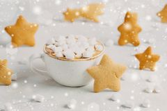Christmas still life: cup of hot chocolate or cocoa with murshmallows and ginger cookies. close up Stock Photography