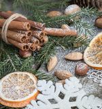 Christmas still life with delicious, almond, cinnamon, snowflakes on wooden table. Close up Stock Photo