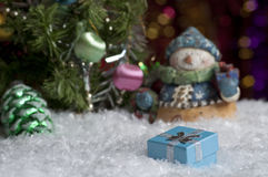 Christmas still life with gift and highlights in the background. Royalty Free Stock Image
