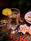 Christmas still-life with glass of hot white wine. Royalty Free Stock Photos