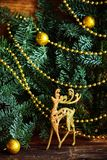 Christmas still life with globes and a golden rendeer. Christmas decor reindeer Golden globes Stock Images