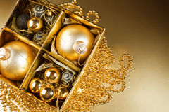 Christmas still life on gold background. Royalty Free Stock Photo