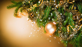 Christmas still life on gold background. Royalty Free Stock Image