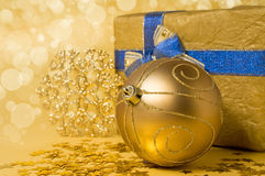 Christmas still life in golden tones Stock Photography