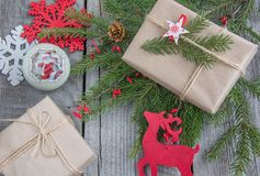 Christmas still life handmade of twigs, gift, reindeer, snowflakes, toys. Stock Photos