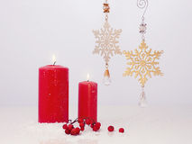 Christmas still life.Happy New Year. Candle and snowflakes Royalty Free Stock Photography