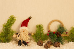 Christmas still life has the Santa Claus. Bright background has tree branches and soft toys Royalty Free Stock Photography