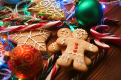 Christmas still life. homemade ginger biscuits, cane candy, on a wooden background. Stock Images